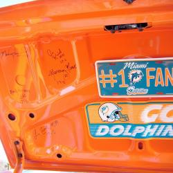 1972 Miami Dolphins signed the boot after their perfect season